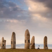 Familia de Menhires by Manolo Paz (1994) is a postmodern set of standing stones in a prominent seaside park in A Coruna.  It stands on the site of a masacre during the Spanish Civil War.Contact: Marita Prieto, Calle San Blas 21, 1st floor,  Seville, 41003  Phone:  +34 954 371668 Or: 00 34 670 56 16 36 Email: maritaprieto@blueyonder.co.uk