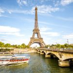 View on the famous Eiffel tower with Seine river and bridge in Paris