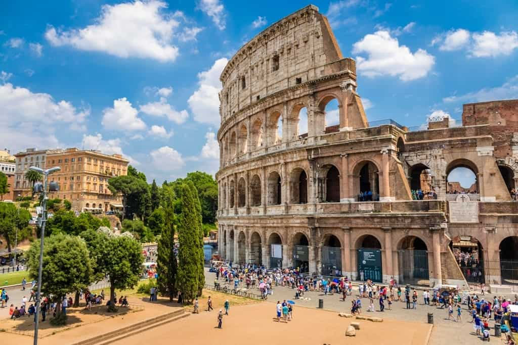 Colosseum-with-clear-blue-sky-Rome-Italy.-Rome-landmark-and-antique-architecture.-Rome-Colosseum-is-one-of-the-best-known-monuments-of-Rome-and-Italy-min