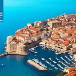 Old fort of Dubrovnik from the bird's view with blue sea and boats