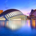 Valencia, Spain - July 31, 2016: The city of the Arts and Sciences and his reflection in the water at dusk. This complex of modern buildings was designed by the architect Santiago Calatrava