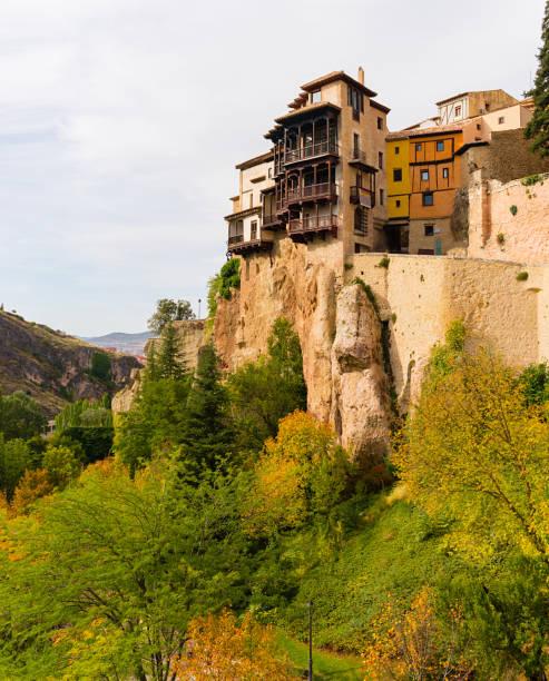 Casas colgadas (hanged houses) on a hill during an autumn day in Cuenca, Spain